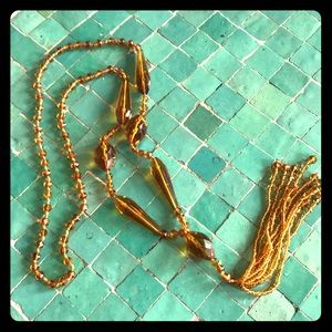 Antique glass beads flapper necklace, amber